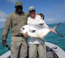 Capt. Whitney Rolle and Kevin Becker with a beautiful Grand Bahama permit. PHOTO CREDIT: Firefly Bonefishing.